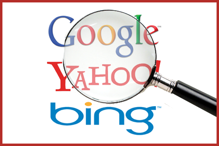 Logos for search engines Google, Bing and Yahoo looking through a magnifying glass.